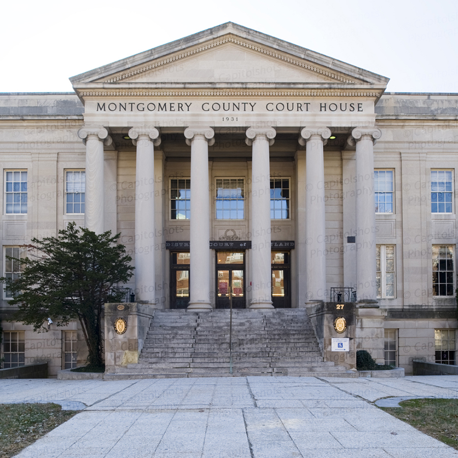 A photo of the Montgomery County Courthouse in Rockville, Maryland.  Completed in 1931, the granite Rockville courthouse, a Classical Revival structure, currently hosts the District Court of Maryland.  The courthouse stands immediately to the west of its 1891 predecessor.  Both buildings are part of the Montgomery County Courthouse Historic District, which is listed on the National Register of Historic Places.  This photo © Capitolshots Photography, ALL RIGHTS RESERVED.